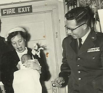 Peg's baptism with Mom and Dad 1954
